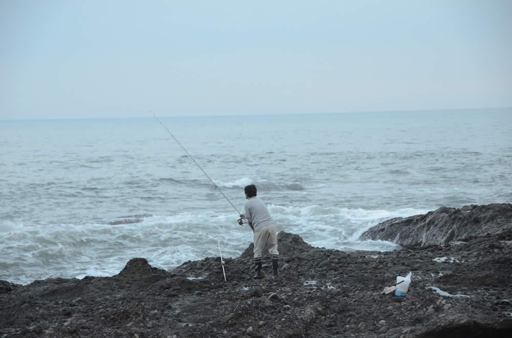 Fishing from rocks along the seacoast